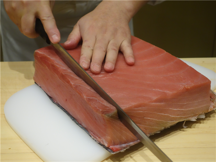tuna being sliced