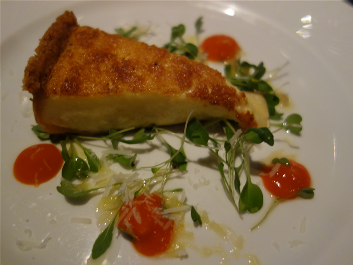 Parmesan tart with red pepper coulis