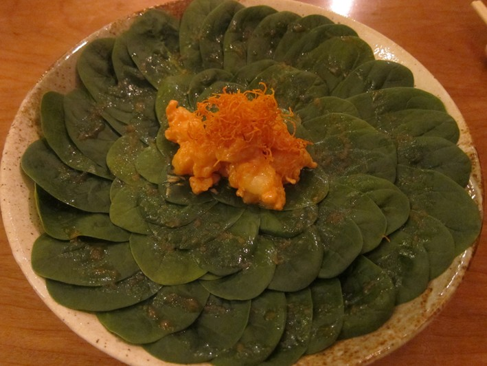 salad of prawns on spinach leaves