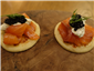 cured salmon on buckwheat blinis