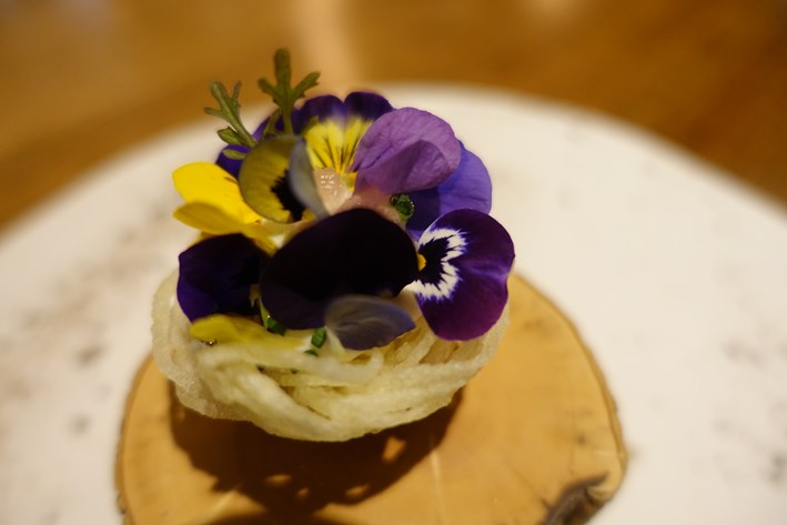 potato nest with eel and edible flowers