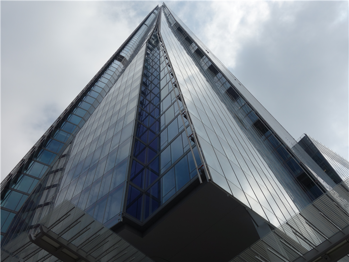 Looking up from the base of The Shard