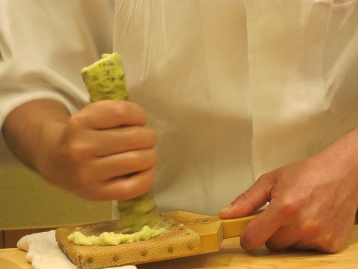 wasabi root being grated